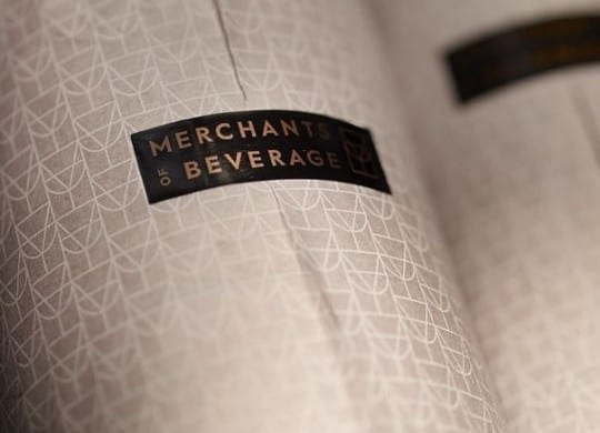 merchants of beverage wrapping bottle